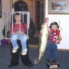 Gorilla Holding a Cage and Fisherman Costumes